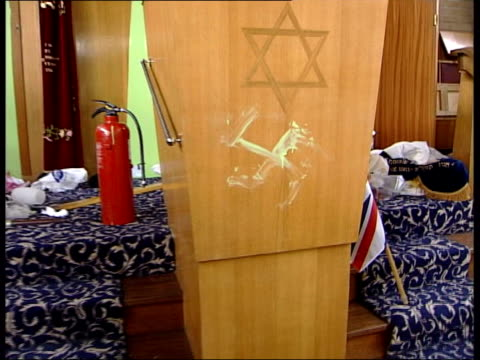 london finsbury park synagogue damaged interior of synagogue which was attacked by racists swastika painted on lectern pan rabbi clearing bebris... - damaged stock videos & royalty-free footage