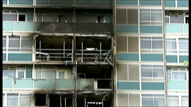london fire brigade issue advice to residents of high rise flats july 2009 fire damaged lakanal house flats firefighters along walkway of lakanal... - ニナ・ホサイン点の映像素材/bロール
