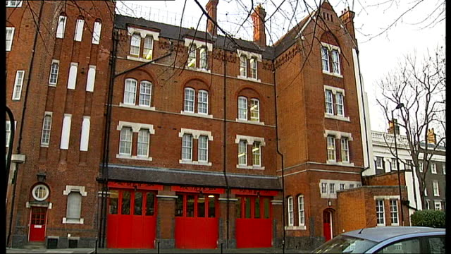 london fire brigade to cut 520 jobs england london southwark ext firefighters walking towards doors of fire station general view front of southwark... - brigade stock videos & royalty-free footage