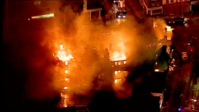 london fire brigade to cut 520 jobs lib / tx croydon night air views of burning buildings during london riots - brigade stock videos & royalty-free footage