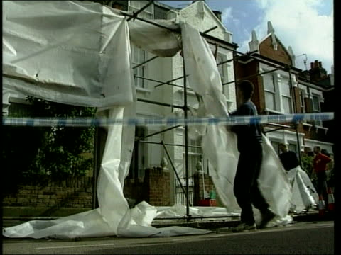 london fulham tarpaulin screen being removed from front of jill dando's house la house - jill dando stock videos and b-roll footage