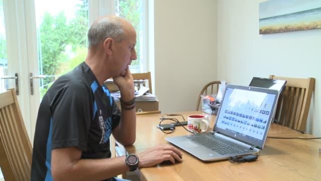 Kevin Webber raises money for charity after prostate cancer diagnosis ENGLAND London INT Kevin Webber at laptop