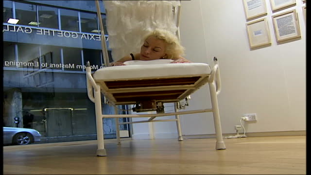 london gallery invites visitors to lie on bed installation england london mayfair alexia goethe gallery int unidentified woman posing in her... - flightless bird stock videos & royalty-free footage