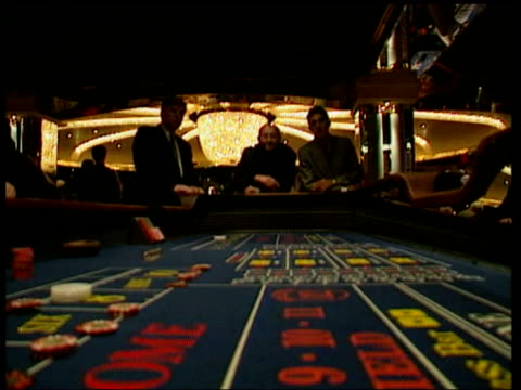 trocadero plans for casino; lib dice table croupier collecting chips cbv people playing slot machines tx 29.3.2004/london tonight - dice stock videos & royalty-free footage