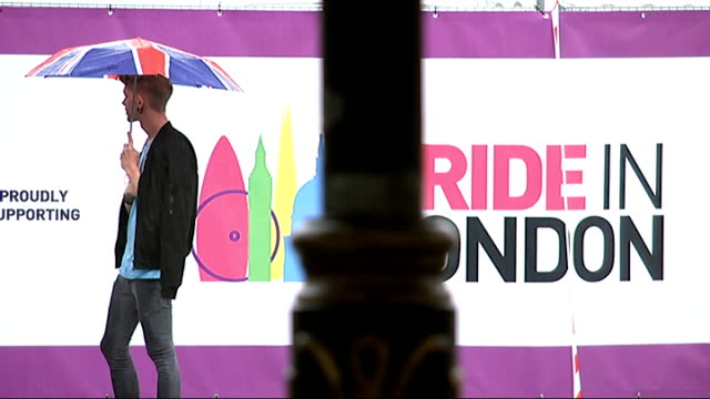 london torrential rainh falling on gay pride tents in trafalgar square pride lndon strwards standing with umbrellas in heavy rain man stands under... - union army stock videos & royalty-free footage