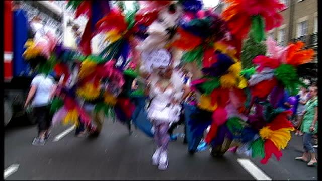 london ext various shots of 2009 gay pride marchers exotic costumes placards and floats - festivalsflotte bildbanksvideor och videomaterial från bakom kulisserna