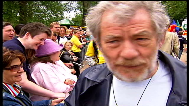 gay pride parade; england: london: hyde park: sir ian mckellen stands chatting to people in crowd, mckellen talking to the press sot - pride stock videos & royalty-free footage