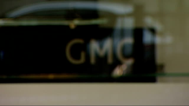 london general medical council ext gmc logo seen through window - general medical council stock videos & royalty-free footage