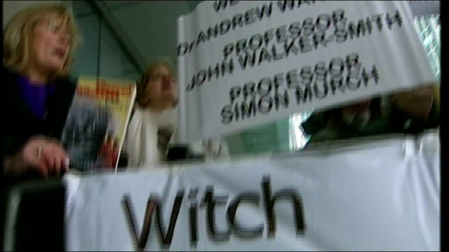 london general medical council ext vox pop woman protesting outside gmc hearing into dr andrew wakefield's 1998 research paper into the mmr... - mmr stock videos and b-roll footage