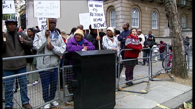 london: general views and close shots of exiled chagossians protesting and chanting outside downing street about their right to return home sot - 追放点の映像素材/bロール