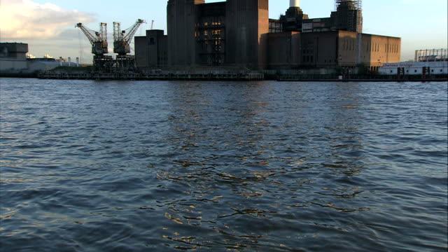 stockvideo's en b-roll-footage met general views of battersea power station/ river thames england london ext good shots of battersea power station seen from river thames / general view... - bare tree