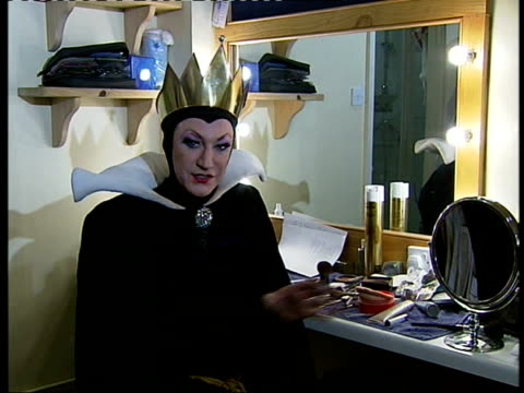 london gir ex victoria palace theatre int lily savage dressed as evil queen interviewed sot been going really well two performance a day/ show is... - paul o'grady stock videos & royalty-free footage
