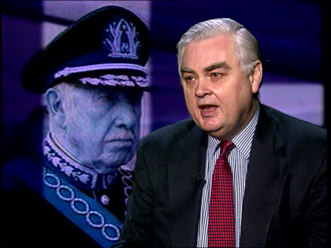 london: gir: int lord lamont of lerwick interview sot - people are interested in revenge, not justice surrey: wentworth: ext anti-pinochet protestor... - b rolle stock-videos und b-roll-filmmaterial