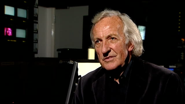 set-up shot of john pilger with reporter john pilger interview sot - this is man who is innocent until proven otherwise / a chaotic case in sweden... - john pilger stock videos & royalty-free footage