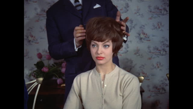 1961 - london - hairdresser changes women's hairstyles - hairdresser stock videos & royalty-free footage