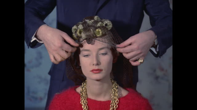 1961 - london - hairstylist examines women's hair - hairdresser stock videos & royalty-free footage