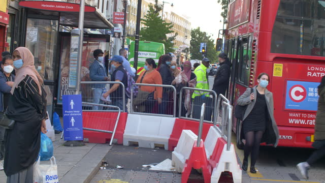 london - harlesden  - high street in poorer neighbourhood people boarding bus sunny day - commercial land vehicle stock videos & royalty-free footage