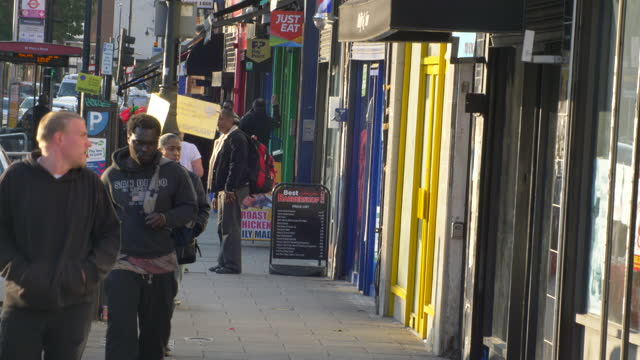 london - harlesden  - high street in poorer neighbourhood people walking sunny day - image stock videos & royalty-free footage