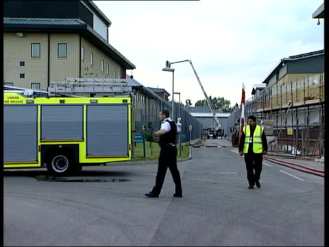 london harmondsworth removal centre harmondsworth sign pull out firefighters next fire engines next asylum seekers detention centre building riot... - removal man stock videos & royalty-free footage