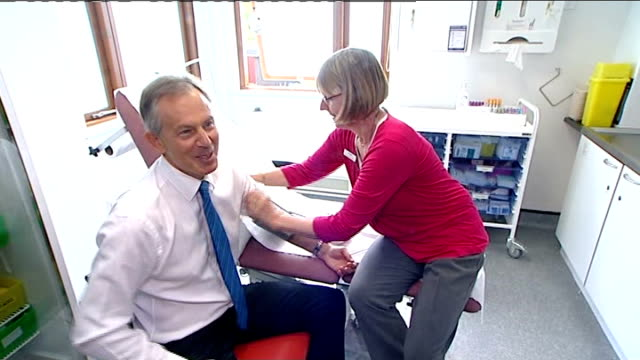 """harrow: int tony blair has his blood pressure taken during visit to new health centre - tells press, """"it's a tough job being prime minister, i know""""... - harrow stock videos & royalty-free footage"""