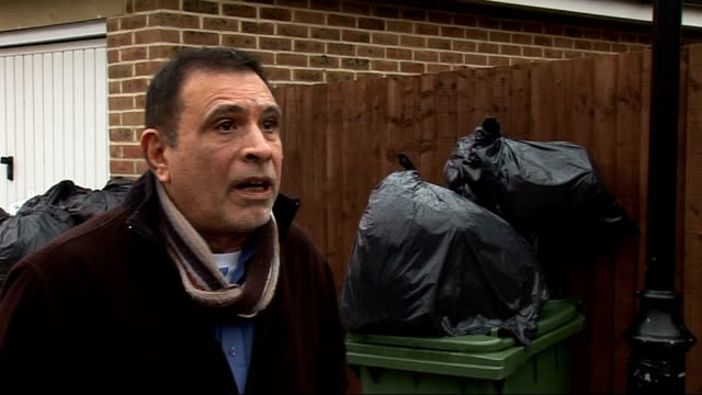 harrow: stanmore: ext bags of rubbish sitting on top of already full bins rubbish bags piled next to full wheely bins rubbish bags on top of bins... - harrow stock videos & royalty-free footage