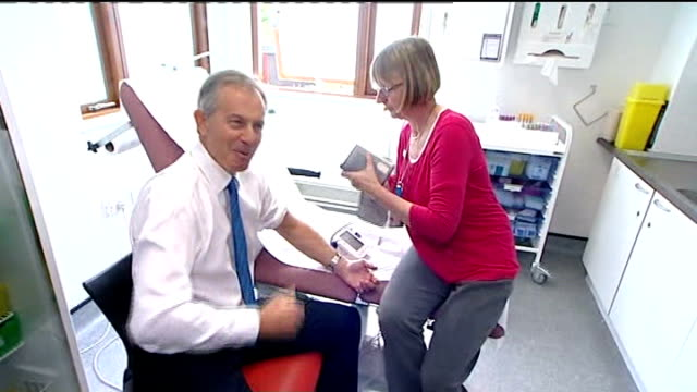 london: harrow: tony blair having blood pressure checked in clinic as speaks to press sot - the question will be is it better or worse than what it... - harrow stock videos & royalty-free footage