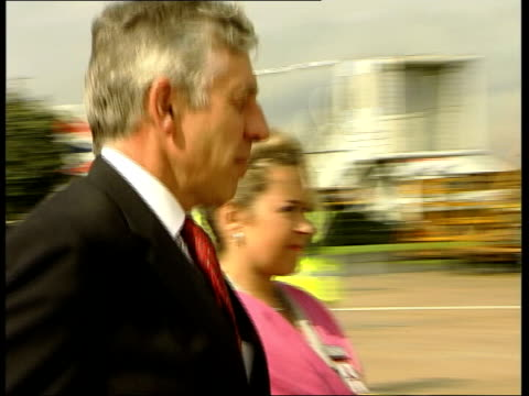 heathrow aiport: ext home secretary jack straw mp towards with woman as shaking hands then away up plane steps jack straw mp speaking to press sot -... - krishnan guru murthy stock videos & royalty-free footage
