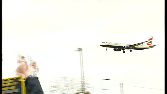london heathrow airport ext striking british airways cabin crew heckling ba flights on their run into heathrow airport sot banner made of pants... - knickers stock videos & royalty-free footage