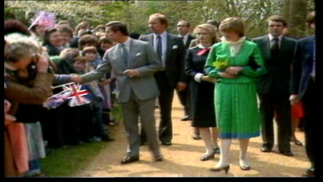 london heathrow airport: prince charles & lady di across tarmac with others as he kisses her goodbye & walks up steps to plane lady di & others... - tidworth stock videos & royalty-free footage