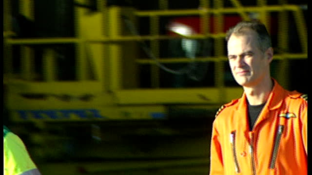 two people killed 2002 captain pete barnes along to helicopter in orange jumpsuit - jumpsuit stock videos and b-roll footage