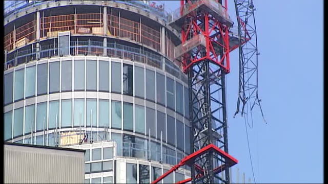 Two people killed Reporter to camera PAN to St George's Wharf tower Closer shot of tower with section of broken crane TILT UP Vox pops male...