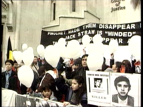 london high court ext gv opponents of chilean dictator augusto pinochet protesting outside court as holding placards with pictures of pinochet's... - dictator stock videos & royalty-free footage