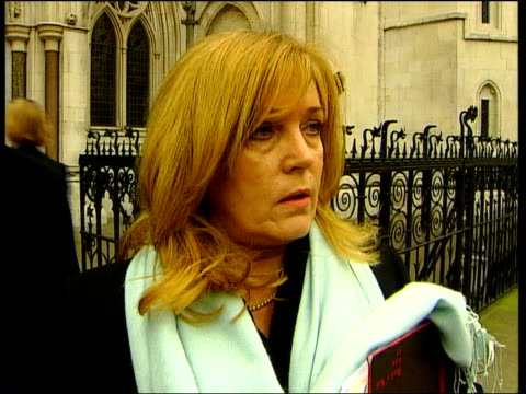 london high court ext kathy saigol towards from court with son after winning damages over house renovation which went wrong ms saigol son posing... - damages television show stock videos and b-roll footage