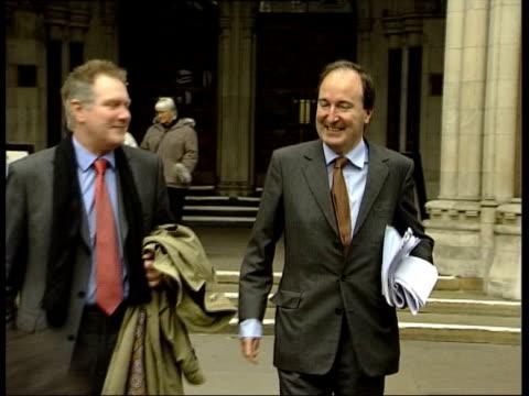 london: high court: ext slow motion charles moore leaving court - krishnan guru murthy stock videos & royalty-free footage