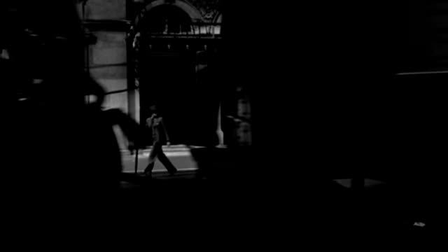 dx - london hotel building - across street to entrance hotel carlton - traffic passing - b&w. - 1930 stock videos & royalty-free footage