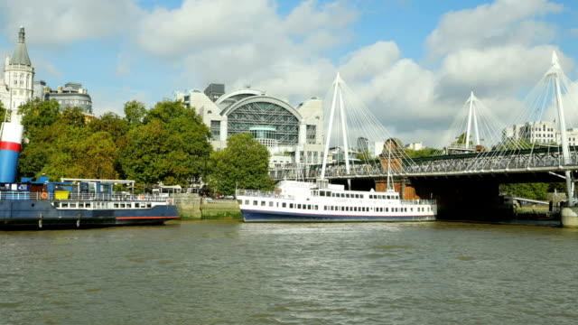 pov london hungerford bridge and golden jubilee bridges - hungerford bridge stock videos & royalty-free footage