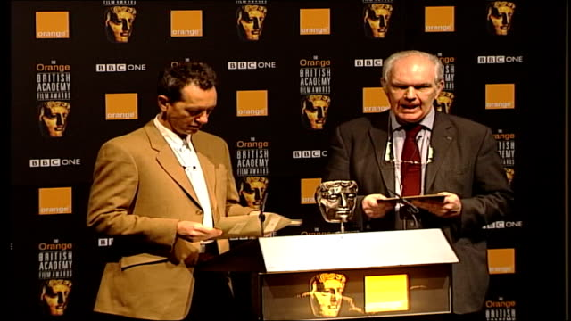vídeos de stock e filmes b-roll de actor richard e grant opening envelope as reading bafta nomination fade to - richard e. grant