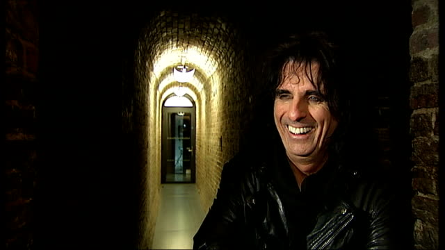 INT Alice Cooper laughing SOTReporter speaking to Cooper
