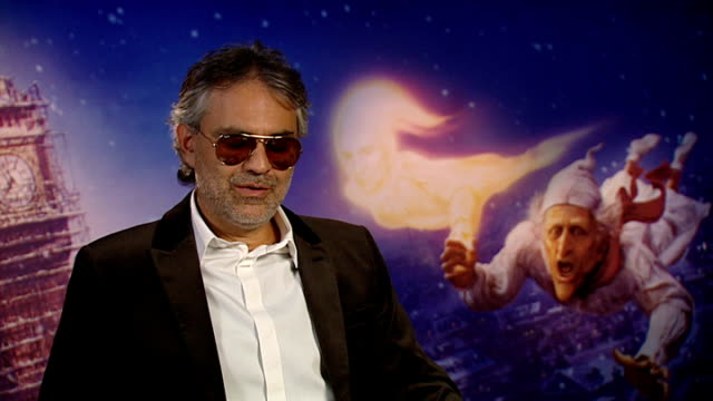 vidéos et rushes de london int andrea bocelli interview sot have sung everywhere including a mountain and it was crazy cold every situation and place is different so are... - andrea bocelli