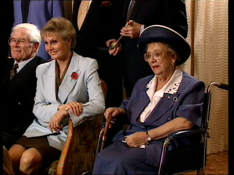 attacked lib london int angela rippon sat next dame thora hird rippon talking with man - thora hird stock videos & royalty-free footage