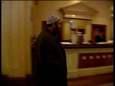 london: int cms abu hamza along hotel corridor track cms side abu hamzaalong thru lobby of hotel lib home secretary david blunkett mp shaking hands... - attorney general stock videos & royalty-free footage