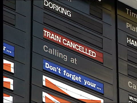 administration lib london destination board at station zoom in 'train cancelled' sign old woman looking up at board passengers along from platform... - information sign stock videos & royalty-free footage