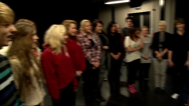 london int general view of havering college students singing original composition called 'i'm a celebrity get me out of here' sot pan - i'm a celebrity... get me out of here stock videos & royalty-free footage