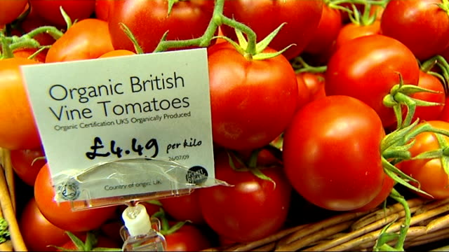 London INT General views organic fruit and vegetables on display Reporter to camera