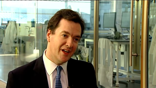george osborne mp towards with reporter and unidentified woman on railway station platform track backwards int train osborne chatting to reporter... - explaining stock videos & royalty-free footage