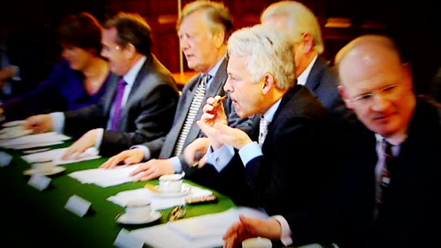 london alan duncan mp eating biscuit - alan duncan stock-videos und b-roll-filmmaterial