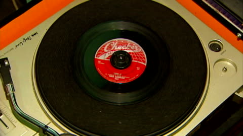 hand placing vinyl 7-inch single on record turntable - putting stock videos & royalty-free footage