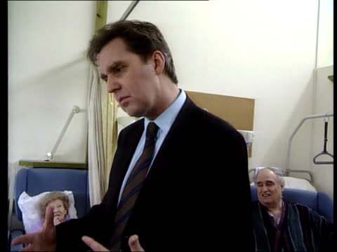 london health secretary alan milburn mp talking to old woman during visit to community hospital man talking to milburn milburn man alan milburn mp... - nhs stock videos & royalty-free footage