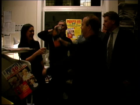 london: int ian hislop swigging from a champagne bottle other private eye staff drinking champagne from plastic cups bv hislop pouring champagne into... - ian hislop stock videos & royalty-free footage