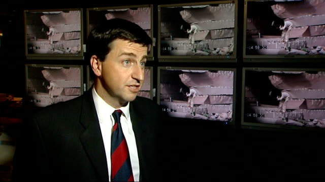 london int international development secretary douglas alexander mp looking at footage with reporter douglas alexander mp interview sot - douglas alexander stock videos & royalty-free footage